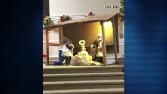 A sheep and Mary fight over baby Jesus during children's play