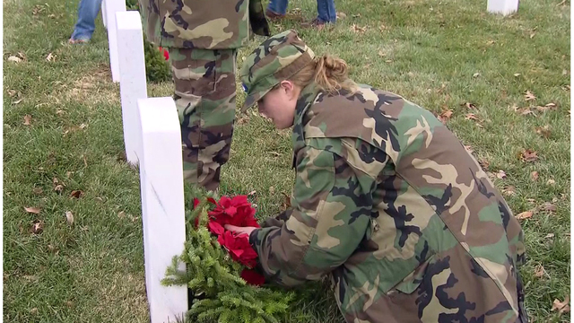 Volunteers unload wreaths for Wreaths Across America ceremony