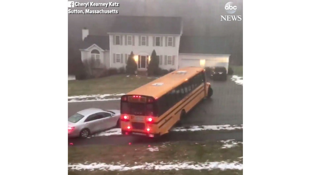 Bus with students aboard slides down icy street